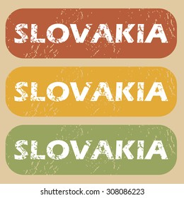 Set of rubber stamps with country name Slovakia on colored background