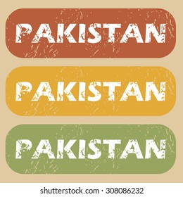 Set of rubber stamps with country name Pakistan on colored background