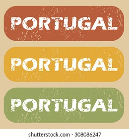 Set of rubber stamps with country name Portugal on colored background