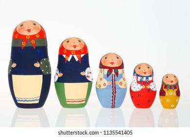 Set of Russian dolls babushka matryoshka lined up isolated on white