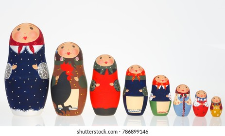 Set of Russian dolls babushka matryoshka lined up isolated on white