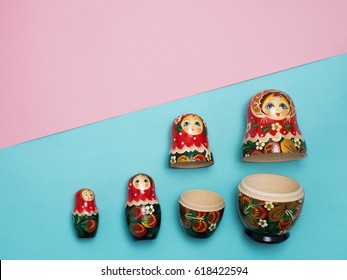 Set of Russian  dolls on color background.