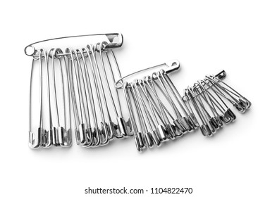 Set of safety pins on white background