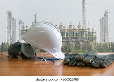 Set of safety work wear on tanker refinery background , Always wear safety equipment and personal protective equipment. image construction concept.