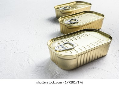 Set of same size close up closed canned food no labels , fish , fruits, vegetables, meat, soup different types of shapes top view onwhite textured background side view space for text