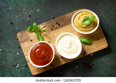 Set of sauces. Homemade Mayonnaise Sauce on the background of stone or concrete. Top view flat lay background.