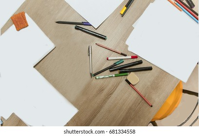 Set of school pupil on paint lesson , graphic designer or graffiti sketcher , pen and pencils on the background of wooden table.   Student material and equipment. Back to school concept . Top view