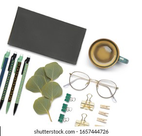 Set of school supplies with cup of coffee on white background