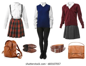 Set of school uniforms with accessories on white background