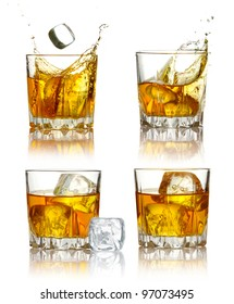 Set of scotch whiskey glasses with splash and ice isolated on a white