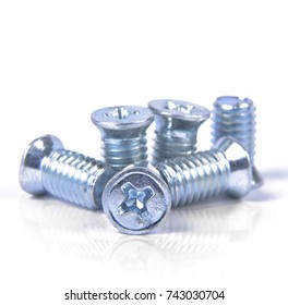 Set of screws on the white background , metal screw