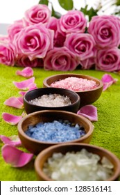 Set of Sea salt in bowl, rose with petals on green soft