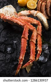 Set of seafood: red and black caviar, limb of hairy crab, limb of snow crab, far eastern kamchatka crab