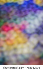 Set of several liners, markers and colored markers caps of different colors. Abstract blurred background from multi-colored caps for plastic pens
