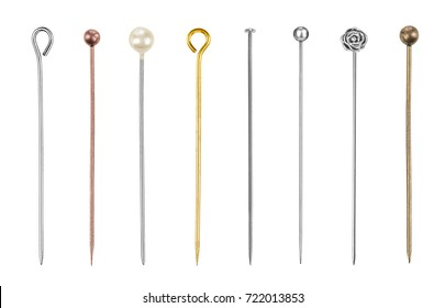 Set of sewing pins on an isolated white background. Decorative pins made of silver, gold, brass and bronze.