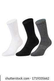 Set of short socks white, grey, black isolated on white background. Three pair of socks in different colors. Sock for sports on invisible foot as mock up for advertising, branding, design.