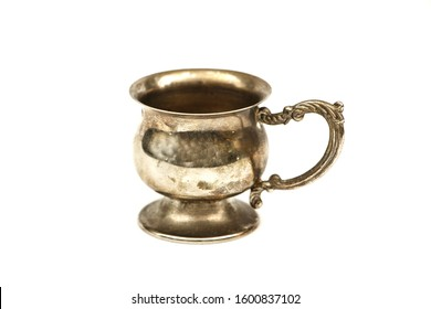 Set of silver dishes for tea or coffee Isolated on a white background. Silver tea or coffee set of utensils on a white background.