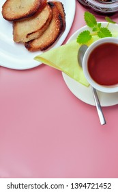 Set for a simple sweet breakfast, fried bread, tea, jam, on a pink background. Place for text.