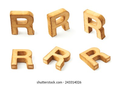 Set of six block wooden capital R letters in different foreshortenings isolated over the white background