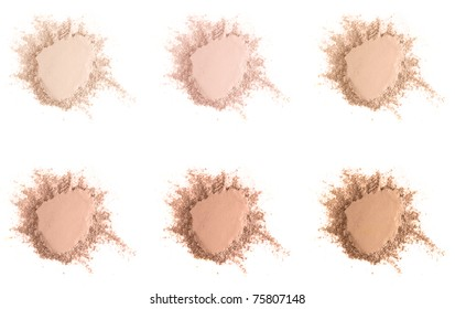 Set of six different skin tone face powder makeup samples isolated over white.