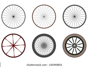 Set of six silhouettes of wheels with spokes on a white background.