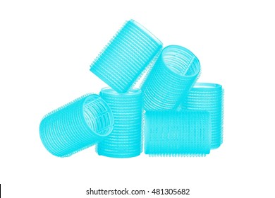 Set of six sky blue hair curlers isolated on white background, with nice reflexion
