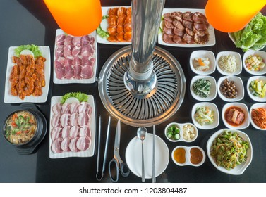 Set of slice raw pork and chicken with red sauce ready to grill korean style, include slide food with vegetable, rice and soup in korean restaurant.