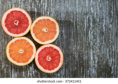 Set of sliced grapefruit isolated on a deep black background