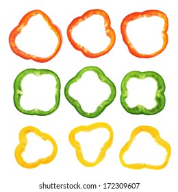 Set of sliced red, green, yellow bell pepper section pieces isolated over white background, top view