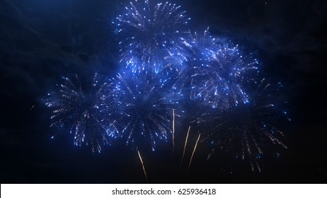 A set of slow motion fireworks on black background, isolated sequence animation without cropping, collage of colorful fireworks exploding in the night sky.