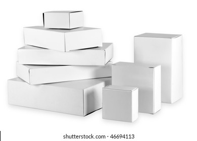 Set of small white  cardboard boxes of the different size. Isolated on white with clipping patch.