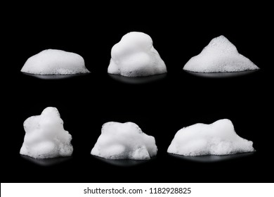 Set of soap bubbles foam isolated on black background.