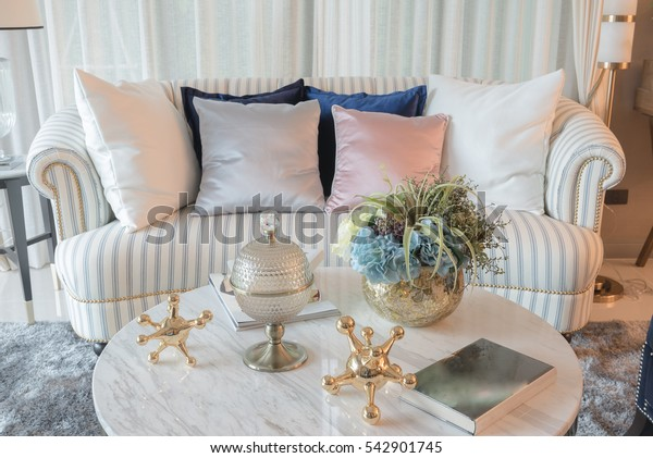 set of sofa with pillows and classic white lamp in luxury living room, interior design