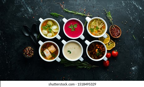 Set of soups. Meat soup, fish soup, chicken soup. Dishes, food. Top view. Free space for your text.