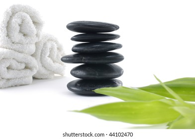 set for spa-*white towel ,stacked stone and bamboo leaf