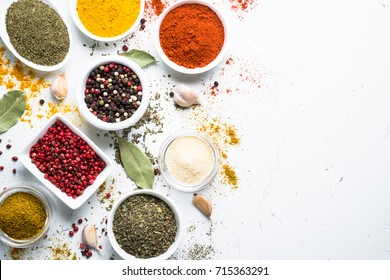 Set of spices in a bowls on white background. Top view.