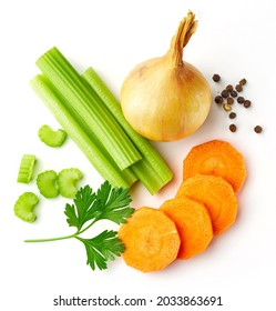 Set of spices for vegetable stock - celery sticks, carrot slices, parsley, onion and black pepper isolated on white background, from above