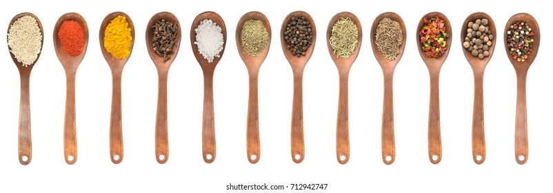 Set of spoons with different spices  isolated on white, top view, high resolution