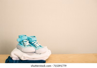 Set of sports sneakers with jeans and a sweater on a neutral background