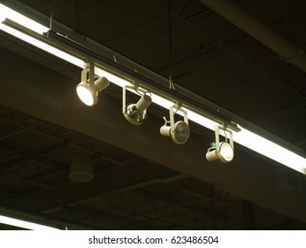 Set of spot lights on a rail hanging from the ceiling