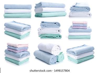Set stack folded towels on white background isolation