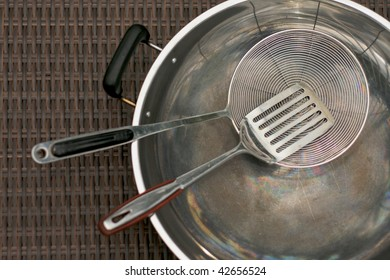 Set of stainless steel cooking utensils kitchenware and wok