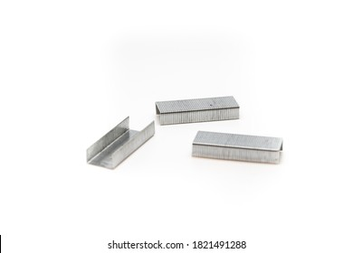 Set of stapler staples paper clips on white isolated background