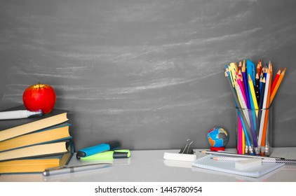 A set of stationery on the background of the chalk board. Back to school concept banner. A large number of pencils, rulers, clips, markers, creatively decomposed with copy space for text.