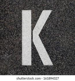 Set of Stencil alphabet letters painted on asphalt road black floor - check my portfolio for other letters
