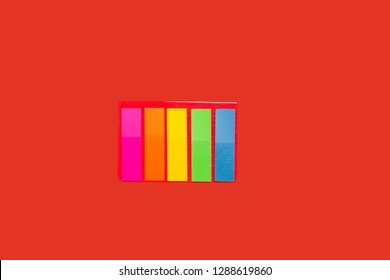 set of sticky notes lying on red background. concept of office stationary