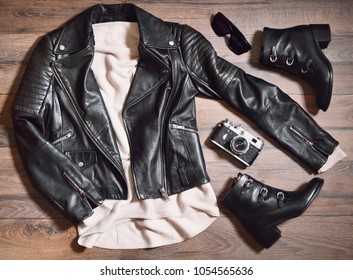 Set of stylish clothes,woman trendy fashion clothes collage on wooden background, flat lay, top view