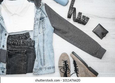 Set of stylish male hipster clothes on wooden background