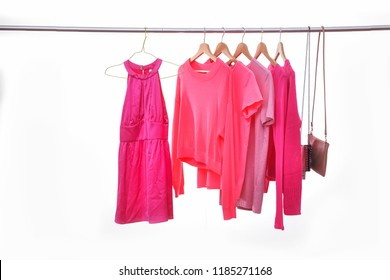 Set of sundress and pink clothes ,handbag on the hanger-white background