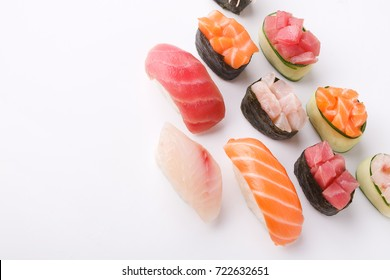 Set of sushi and maki isolated at white background. Salmon, tuna and seebas nigiri. Asian healthy restaurant food delivery